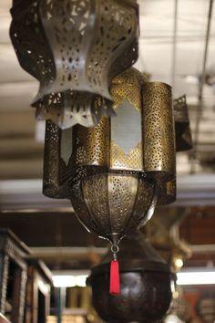 brass Moroccan lanterns  at Badia Design - via  Remodelista