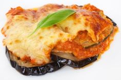 Lowfat Eggplant Bake     Ingredients  Serves 4  1 lb eggplant, cut into 1-in cubes  2 1/2 tsp olive oil  Salt and freshly ground black pepper to taste  1 cup prepared tomato sauce  1 1/2 tbsp chopped fresh basil  1 1/2 cups shredded low-fat mozzarella (8 oz total)    Directions  Preheat oven to 500 ° F. Toss the eggplant with the olive oil and season with salt and pepper. Place on a baking sheet and roast, tossing occasionally, for 20 minutes, or until golden. Reduce the oven temperature to 425 ° F. Transfer the eggplant to a 1 1/2-quart baking dish. Add the tomato sauce and basil and toss to coat the eggplant. Layer the mozzarella on top. Bake for 20-25 minutes, or until golden.
