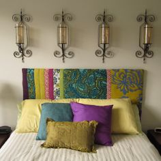DIY your very own upholstered headboard. It's a quick way to make a statement in a sometimes-forgotten guest bedroom.