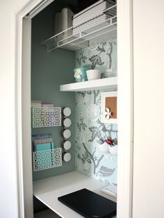Small place? Turn your extra closet into a cute office space.