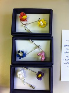 lapel pins of uncle beebo's: http://unclebeebo.tumblr.com/post/19247053033/look-what-just-arrived-my-new-lapel-flowers-from