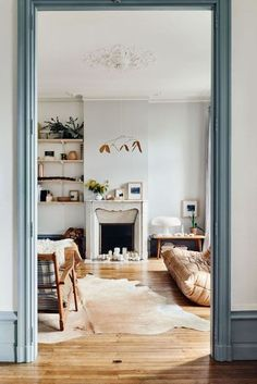 French blue door trim framing a light-filled casual, bohemian-styled living room inside.