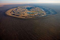 Volcanic crater of Wau Al Namus, Libya. Aerial from above by George Steinmetz