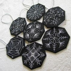 Embroidered snowflake ornaments - I think I found a new December project! (tutorial here: http://nzjo.blogspot.com/2009/11/felt-snowflake-ornies-partie-deux.html)