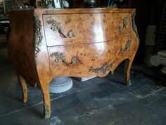 I never seem to learn my lesson about antiques and the things attached to them. Brought home this old French Creole bombe chest from a curiosity shop in the Bywater district of New Orleans (seen here at the shop). Since it's been here we've seen blue orbs, experienced cold spots and seen a figure standing near
