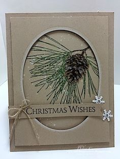 Stampin' Up! ... handmade Christmas card from ARTfelt Impressions .... kraft ... window oval with white sponging around the edge ... pine branch image ... like the popped up panel ... framed work of art ... great card!