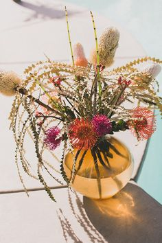 tropical floral arrangement, photo by Studio Castillero http://ruffledblog.com/modern-ace-hotel-wedding #weddingideas #poolsidewedding