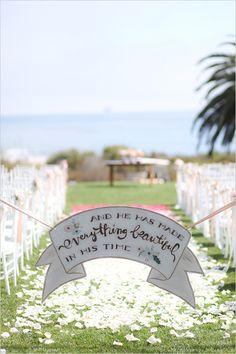 Wedding sign at wedding ceremony.