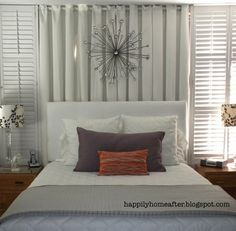 Love the shutters on each side of the bed.