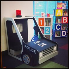 New police car in the children's picture book room as part of the library's Community Helpers renovation.