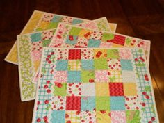 If you're a beginner quilter and are looking for free quilted placemat patterns to brighten up your kitchen, you're sure to love this tutorial for making these lovely Cherry Jelly Roll Placemats.