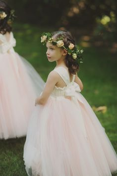 Peach rose and greenery hair wreath on angelic flower girl