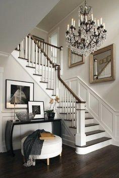 dark wood, light walls, chandelier