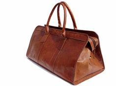 Handmade Soft Leather Duffle (LeftoverStudio via Etsy, $119.00) - Overnight Cabin, Sports Gym Handbag, Bags for Weekend/Picnic, Travel Bag, Vintage Retro Looking, made from traditionally tanned natural goat leather.