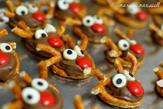 Pretzel Rolo Bites with a Reindeer twist - Heat oven to 200.  Place tiny twist pretzels on a cookie sheet and place one rolo on top of each one. Put them in the oven for a few minutes. When they are squishy, take them out and press the broken pretzel antlers), white choc chip eyes and red M nose into the chocolate. Dot the eyes with mini chocolate chips or an edible marker!