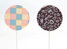 Forget the cigars - hand out these baby themed chocolate lollipops instead.