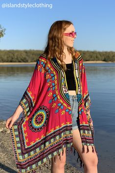 A stunning loose fitting throw over Kimono in a Dashiki design that is African inspired. Features bright colours, abstract patterns, made from a soft rayon that feels wonderful on the skin. Perfect to compliment your everyday wear, throw over your swimsuit or bikini, beach parties, cruising, music festivals. Many other colours available. #kimono #coverup #beachcoverup #dashiki #dashikiprint #dashikicoverup #africanprint #african #africankimono #dashikikimono #beachwear #cruise #casual #fashion