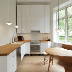 ~ minimal L-shaped kitchen + small kitchen + white + light wood tones + windows + natural light