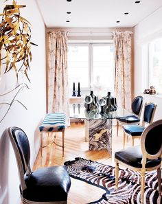 Tour a Fashion Designers Feminine Abode// marble base dining table, brass bench