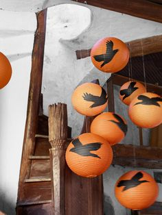 Orange paper lanterns take an ominous turn with a little help from plain tissue paper.