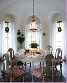 beautiful Swedish breakfast room: love the tiny wreaths on ribbons; centerpiece; Gustavian gray chairs + table (my favorite style); red + white checked fabric