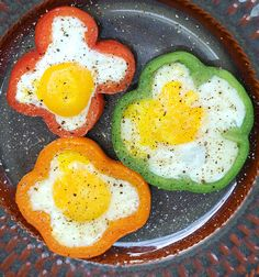 Cut the bell pepper into 1.5cm rings; place in a non-stick lightly oiled skillet. Now crack an egg in the middle of each ring and cover and cook over low heat until done. If you like your yolks runny, just cook over low heat until whites are done. If you like your yolks firm, break the yolks and then cook over low heat until both whites and yolks are firm.