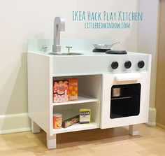 IKEA Hack Play Kitchen  | littleredwindow.com  |  Make an adorable play kitchen with sink, stove, oven, fridge and microwave all from a set of old nightstands!   #craft #diy #ikeahack #playkitchen