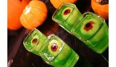 Food Porn: Slime Lime Jello Shooters~T~ Made with lime jello, lychees, maraschino cherries, and black grapes. For adults replace the cold water with Vodka.