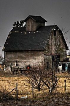 Great old weathered barn with a black roof.