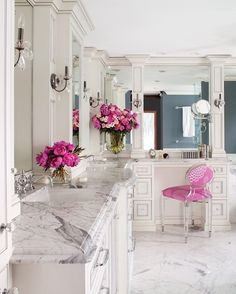 Elegant white cabinetry  marble #bathroom perfectly set off with deep rose accents ~ #RealEstateMPL #DecoTrends