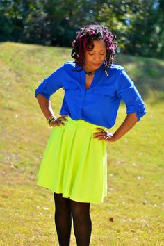 Calvin Klein cobalt blue roll tab shirt worn from Savers worn with lime green skirt.
