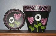 Hand painted flower pot with cute painted flowers. $15.00
