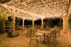 Pergola lit with Christmas lights....this is a restaurant pergola...I am going to use this idea at home....