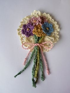 The very cute  Little Doiley Flower Corsage, free pattern by Penny Peberdy .