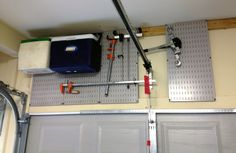 Wall Control metal pegboard is great at turning wasted space into valuable storage areas! If you have space above your garage doors then we can create a great place to hang coolers and other bulky items that take up valuable floor space.