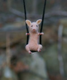 Tiny Pig Necklace / sculpture  needle felted by motleymutton