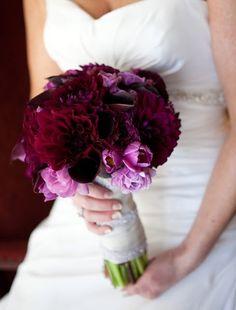 Wine red bridal bouquet  A bridal bouquet made with plum dahlias, eggplant mini calas, lavender ranunculas and purple tulips