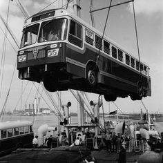 Loading a bus for export to Cuba 1964 | Museum of London