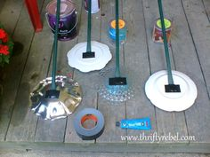 Setting the Garden with Plate Flowers :: Hometalk Uses Marine goop adhesive instead of drilling holes