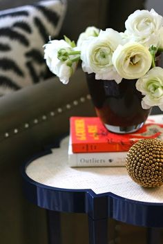 Love the painted side table.