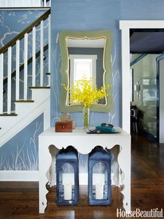 The curves of the foyer's Made Goods mirror mimic the lines of the Swedish Rococo console by Tara Shaw Maison.
