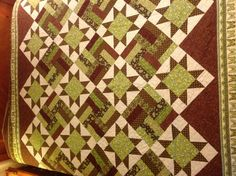 Greens and browns, a bit traditional. earthi quilt