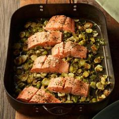 Garlic Roasted Salmon & Brussels Sprouts   Roasting salmon on top of Brussels sprouts and garlic, flavored with wine and fresh oregano, is a meal that is simple enough for a weeknight meal yet sophisticated enough to serve to company. Serve with whole-wheat couscous.