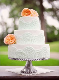 mint green and orange ranunculus wedding cake by vicky