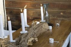 Candle stick made from a repurposed tree trunk and chandelier parts. www.songbirdblog.com