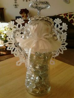 Snowflake Angel - glass beads, Pace Salsa jar, styrofoam ball, coffee filter, ribbon, plastic snowflakes, glitter pipe cleaners