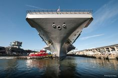 The ship is carefully guided out of her berthing to begin sea trials. The ship spent four years at Newport News Shipbuilding undergoing Refueling and Complex Overhaul (RCOH)