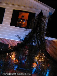 Don't forget the upstairs windows. Add a prop and light it with a spooky color. This one stopped traffic.