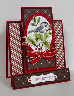 handmade Christmase card ... fancy fold design ... luv the coloring of the bird in the holly ... elegant look ..