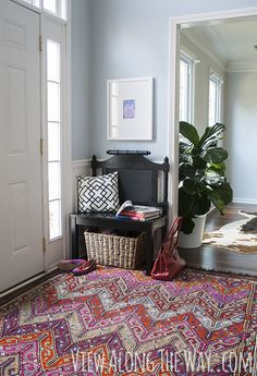 Turn a headboard into a bench for entryway seating!
